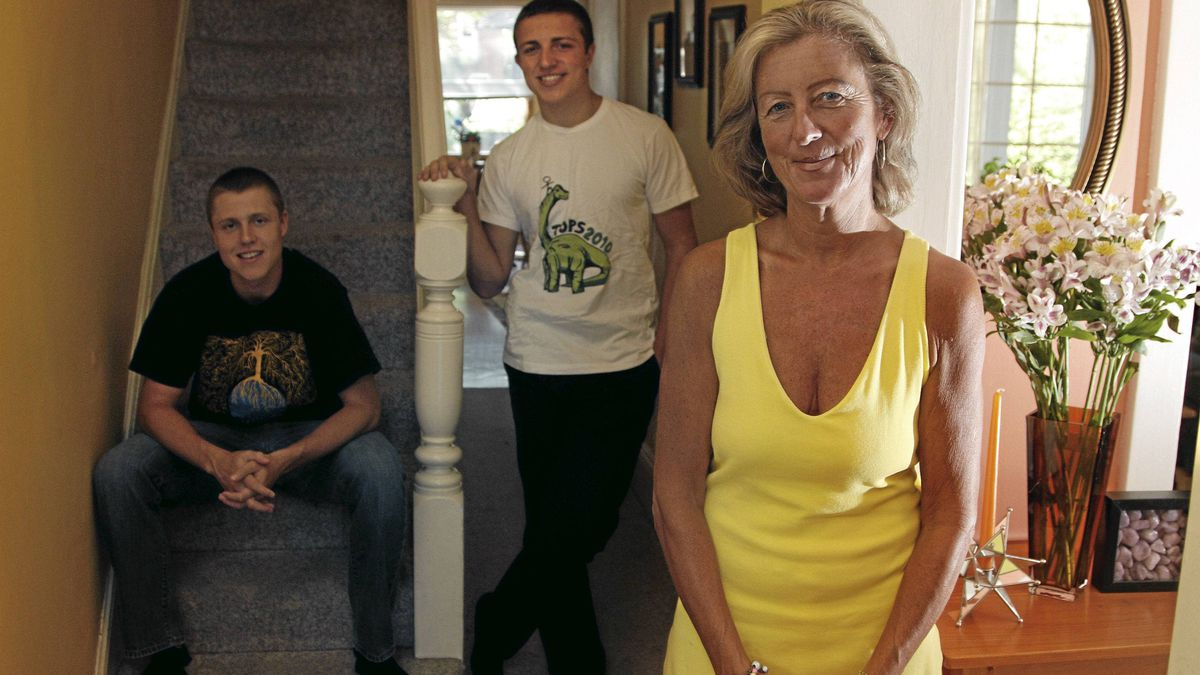 Mara Cole and her sons Evan (left) and Darren at home in Toronto Aug.10, 2011.