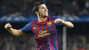 Barcelona David Villa celebrates after scoring against Viktoria Plzen's during their Champions League Group H soccer match at the Nou Camp stadium in Barcelona, October 19, 2011.