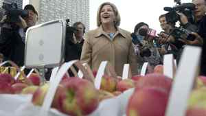 Ontario NDP leader Andrea Horwath walks around Nathan Phillips Square overlooking a farmers market as the media swarms her during a campaign event in Toronto on Wednesday, Oct. 5, 2011.