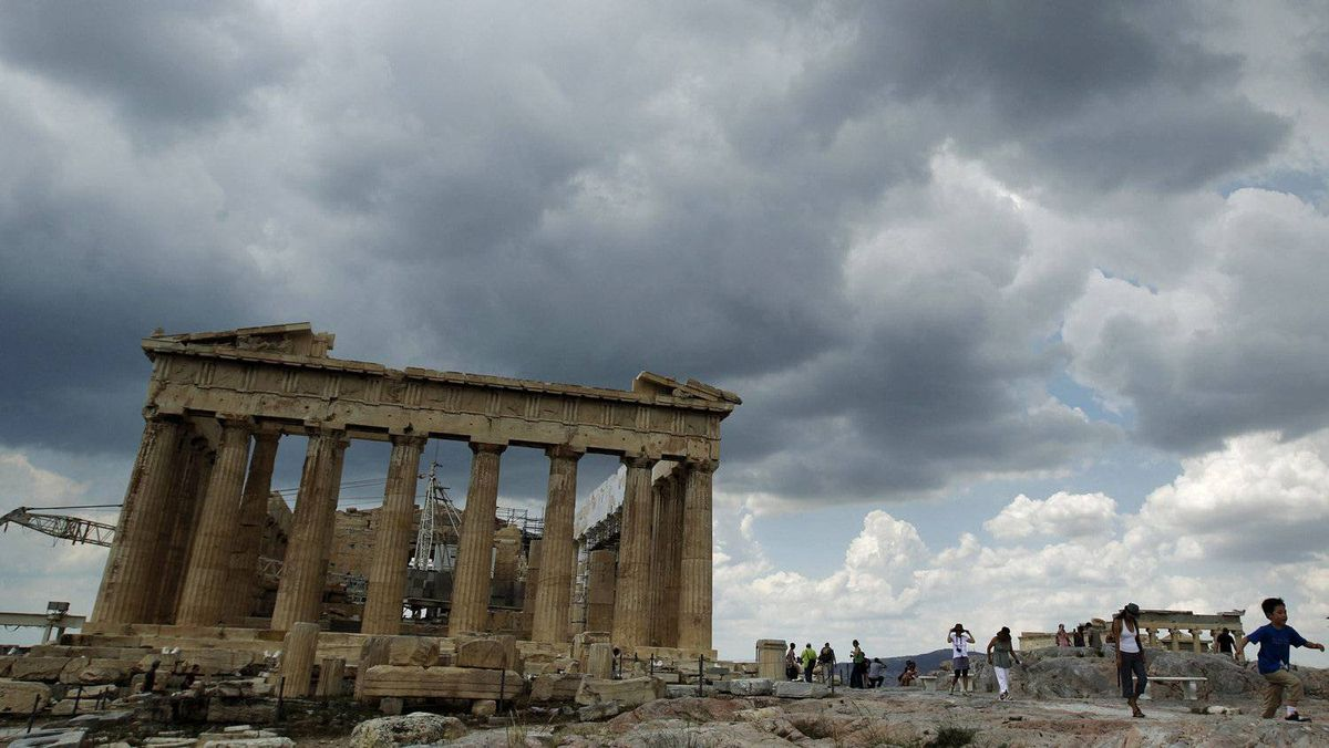 Tourists walk around the temple of the Parthenon at the archaeological site of the Acropolis hill in Athens.