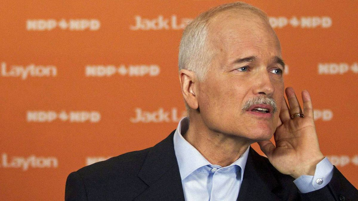 NDP Leader Jack Layton takes questions after a campaign stop in downtown Montreal on April 23, 2011.