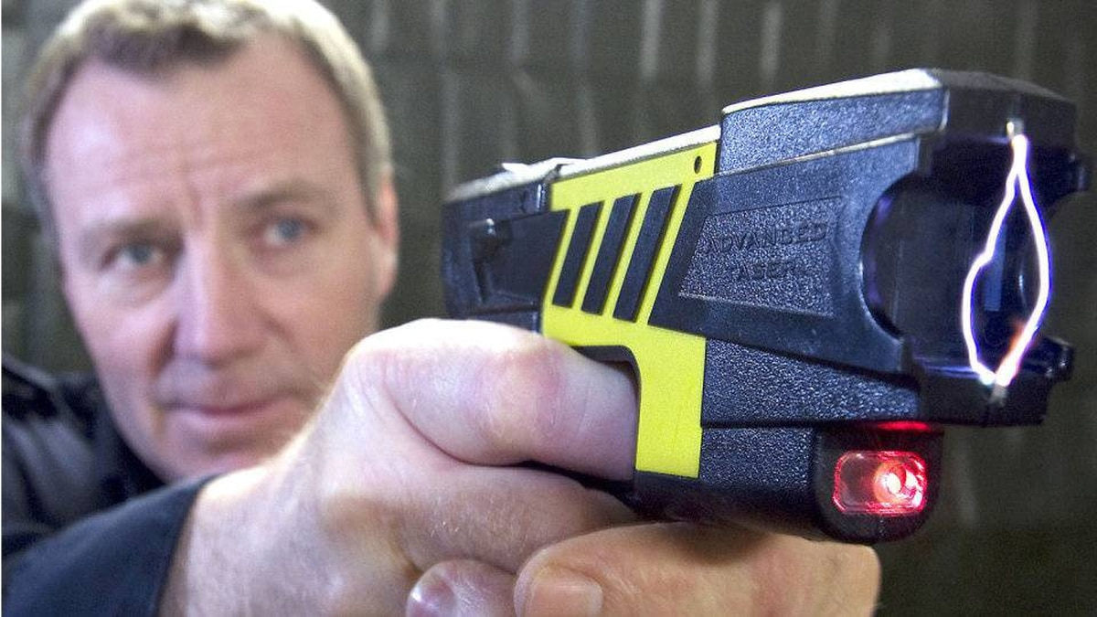 Sergeant Gord McNevan demonstrates the use of a taser at police headquarters in Peterborough, Ont.