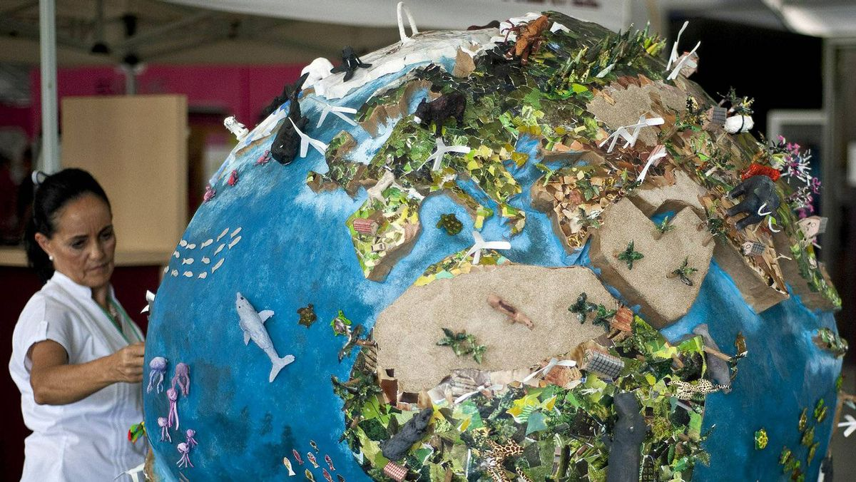 A woman looks at a model of the Earth during United Nations climate talks in Cancun, Mexico, on Nov. 30, 2010.