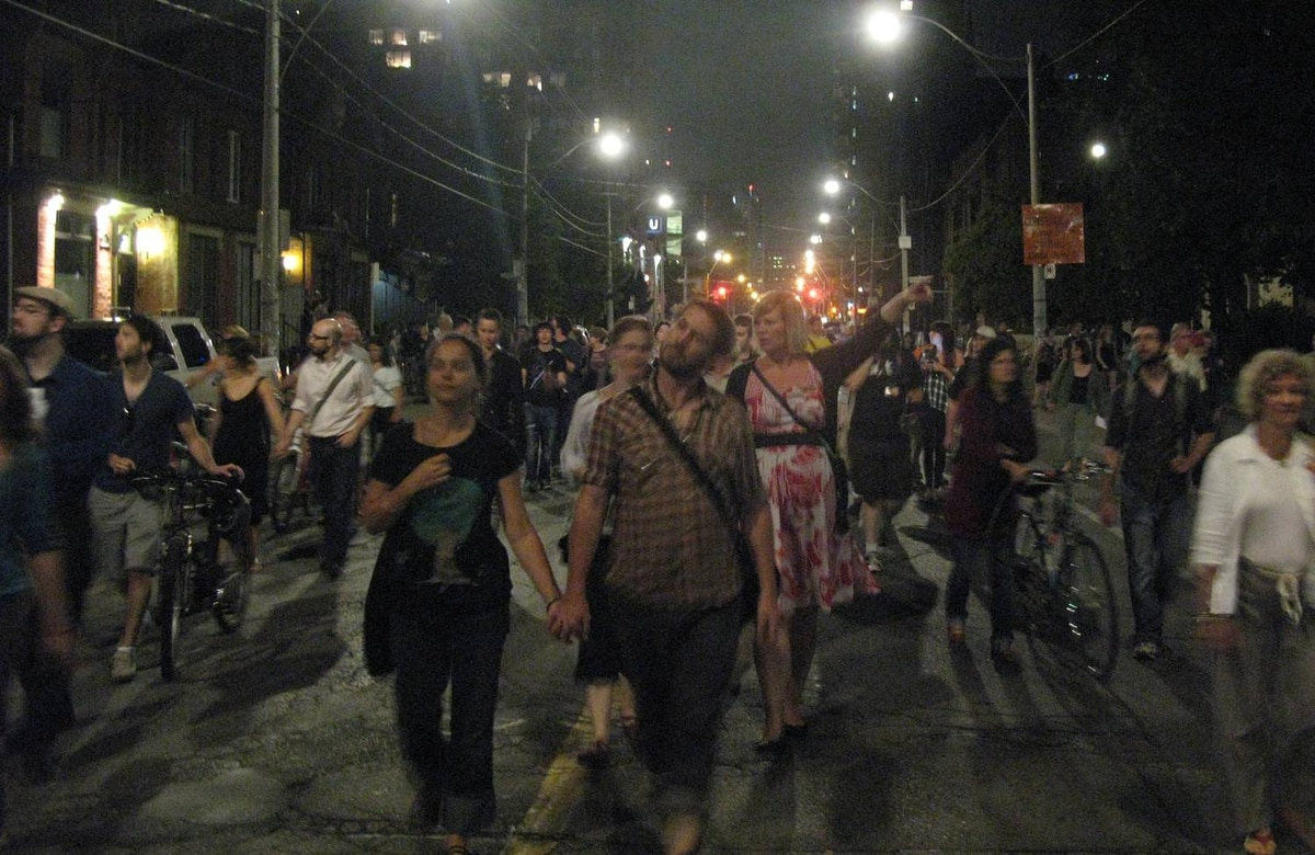 Protesters march from Massey Hall to the makeshift tent city in Allan Gardens.