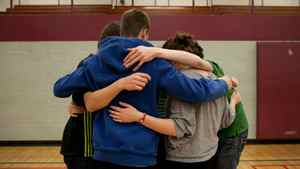Students at Preston High School in Cambridge, ON have a group hug as they participate in a day-long anti-bullying program presented by Phil Boyte Apr. 25, 2012.