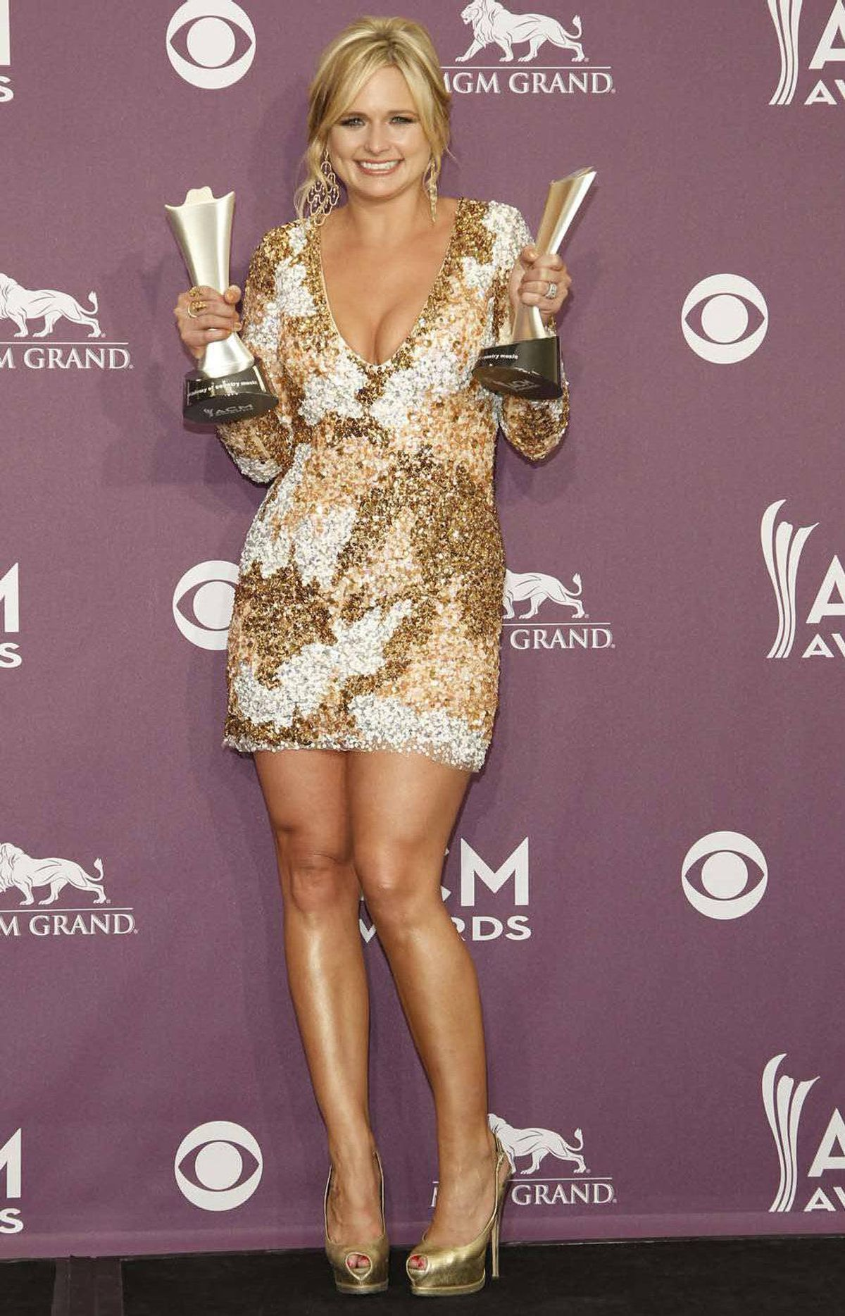 Later, Miranda Lambert proudly displayed her pair of trophies backstage at the Academy of Country Music Awards in Las Vegas on Sunday.