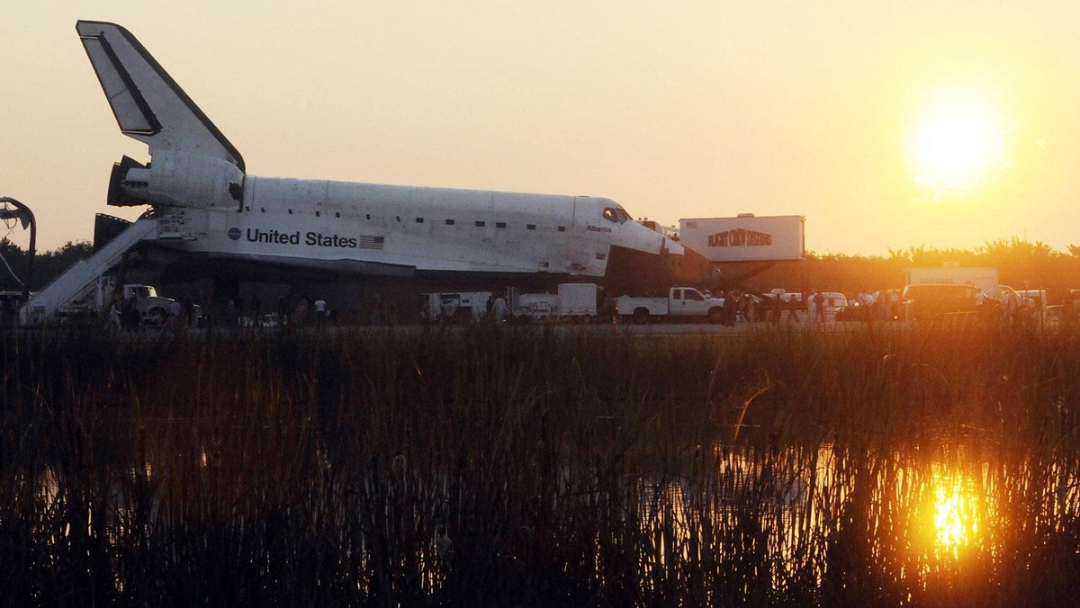 The space shuttle Atlantis is serviced on July 21, 2011 after landing on runway 15 at Kennedy Space Center, Florida.