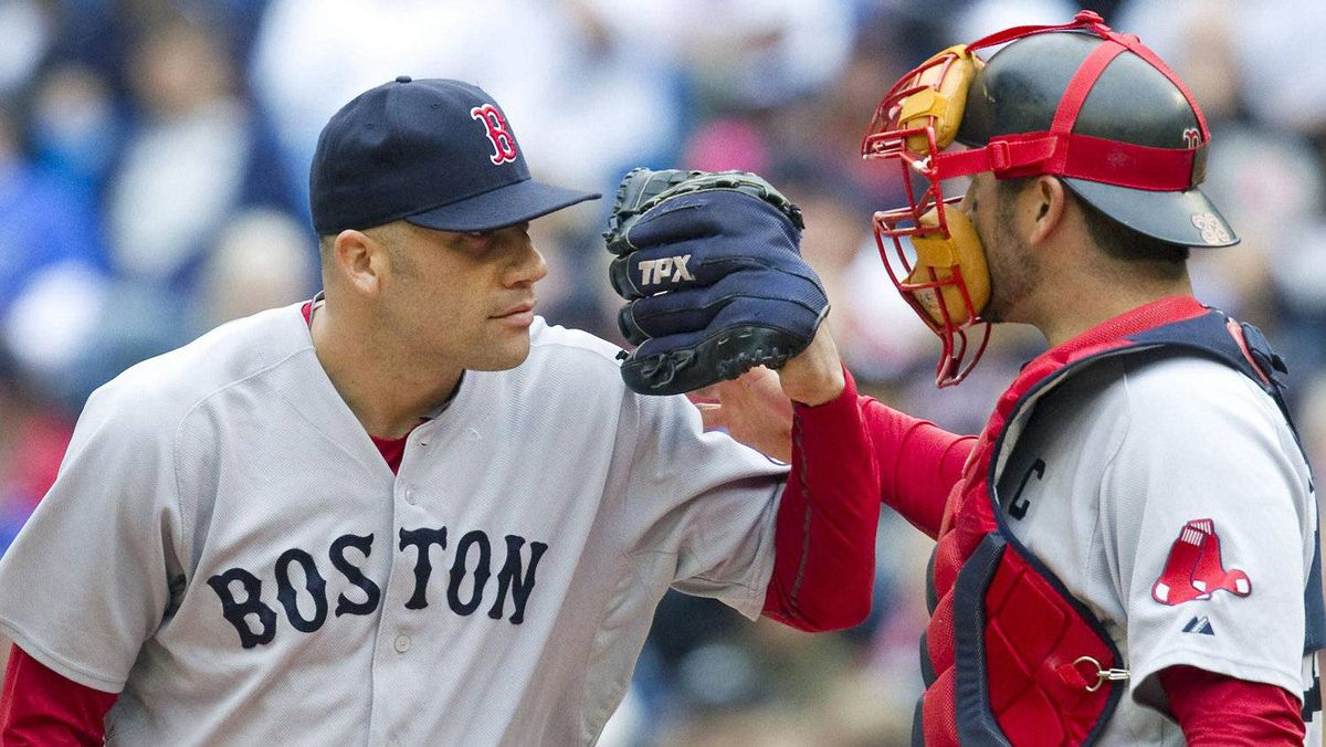 Boston Red Sox pitcher Alfredo Aceves (L) gestures to catcher Jason Varitek in the fifth inning . REUTERS/Fred Thornhill