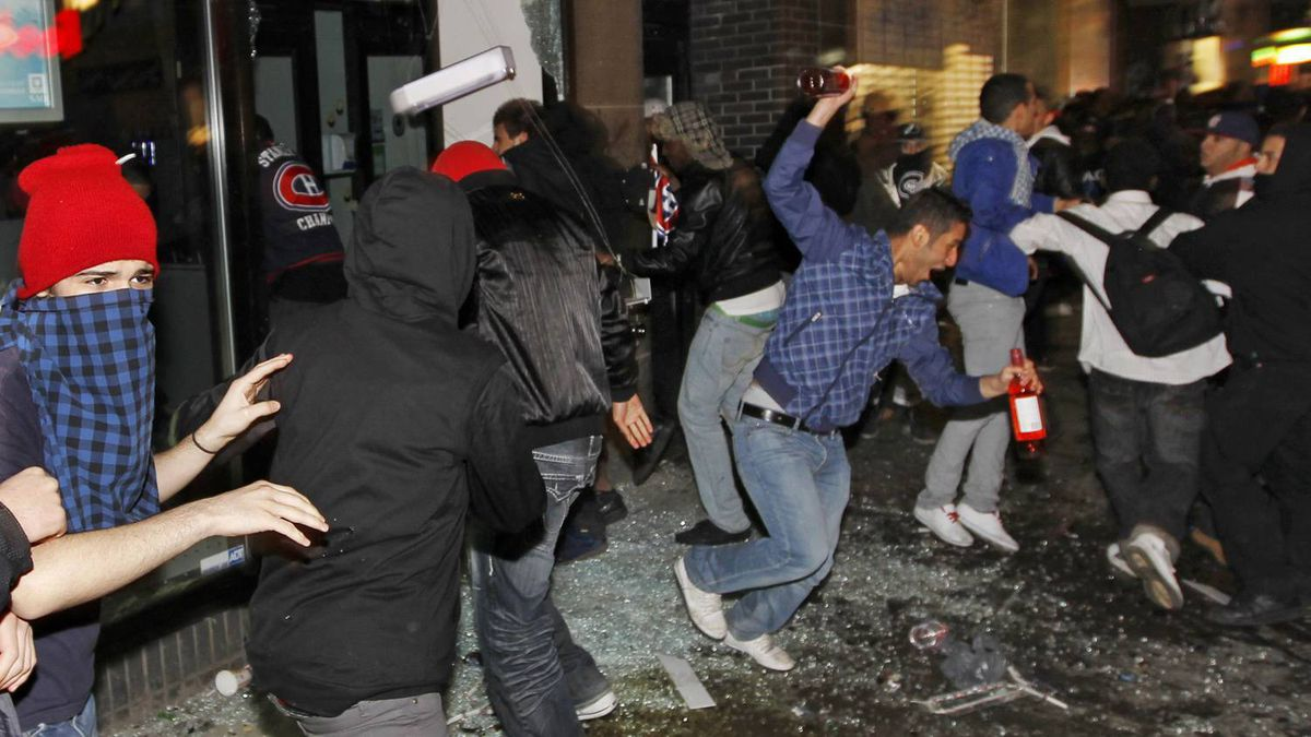 A liquor store is looted after hockey fans celebrating the Montreal Canadiens victory over the Pittsburgh Penguins, turned violent in downtown Montreal, May 12, 2010. REUTERS/Shaun Best