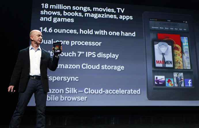 Amazon CEO Jeff Bezos holds up the new Kindle Fire as he speaks at a news conference during the launch of Amazon's new tablets in New York last September.