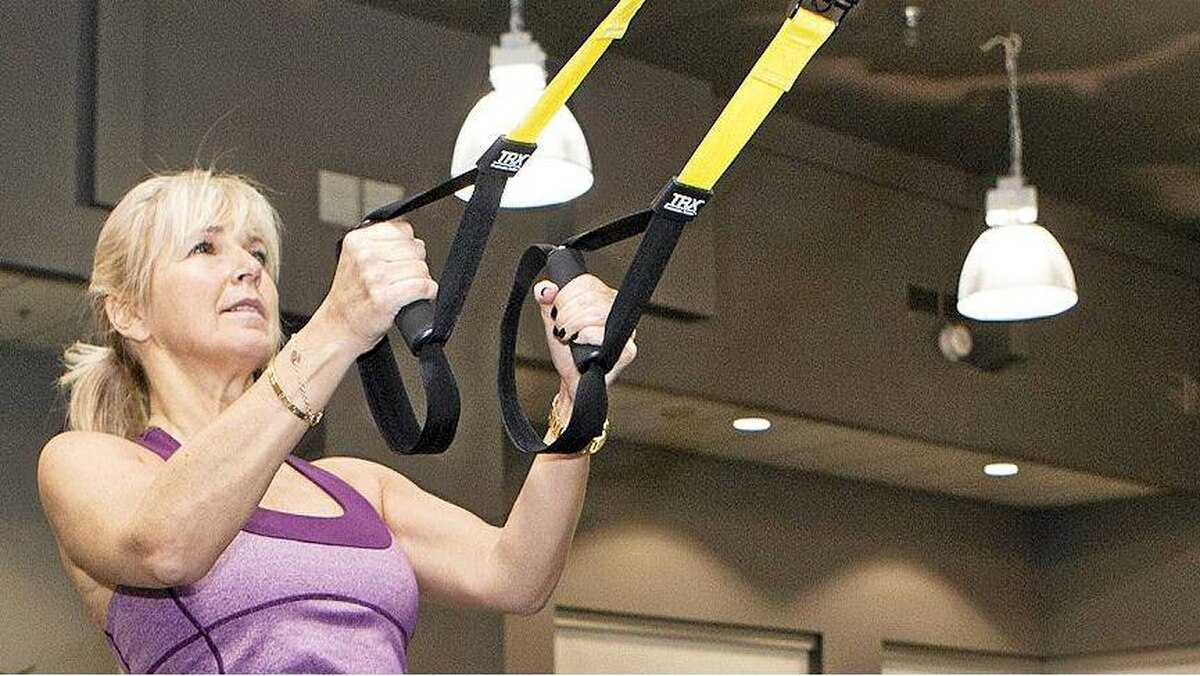 Karen O'Connor, president of the Canadian Sir Edmund Hillary Foundation, trains on TRX at the Gary Roberts High Performance Centre and Fitness Institute.