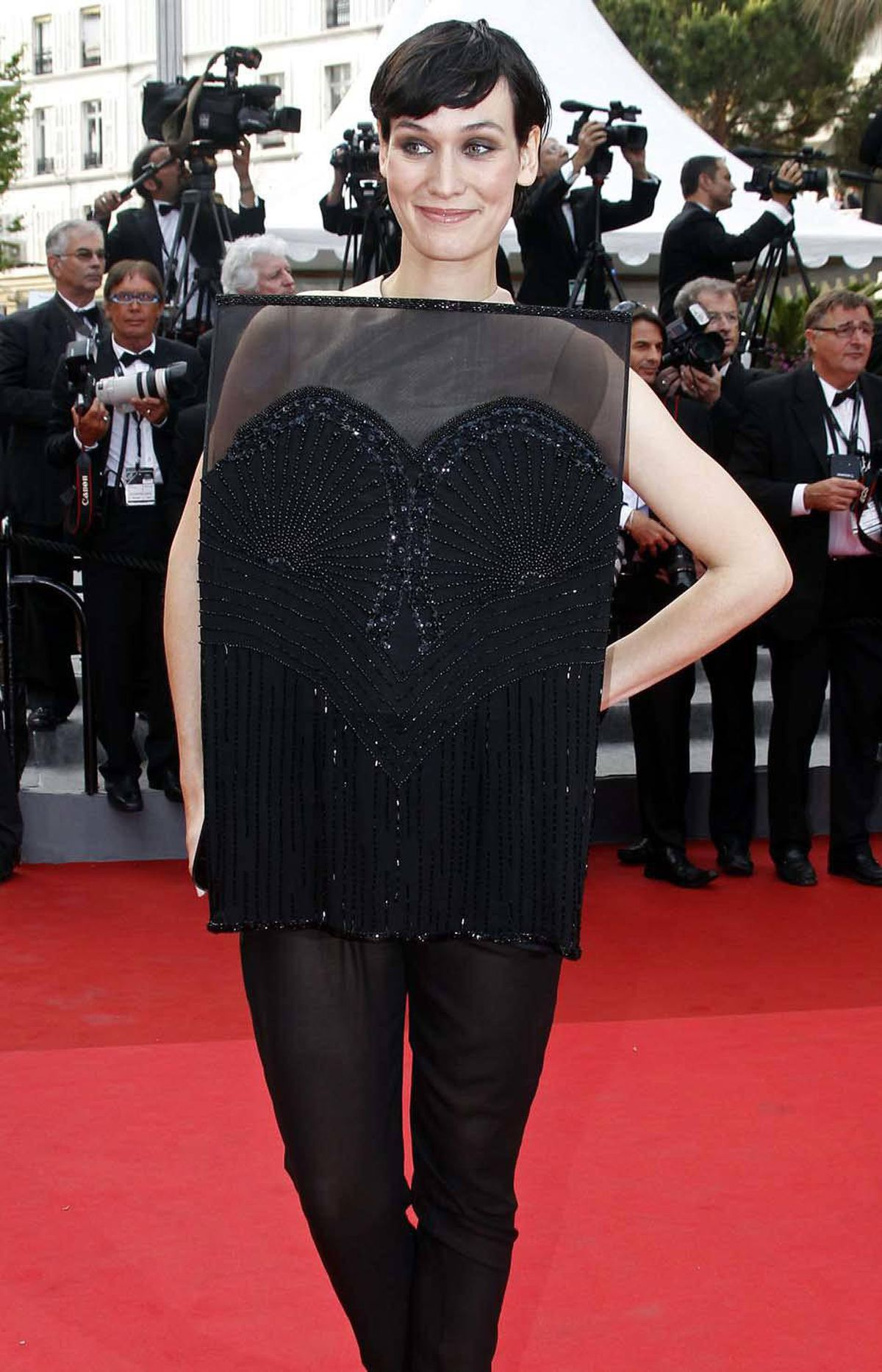 French actress Clotilde Hesme is your French Actress of the Day for wearing an outfit on the red carpet that mimics the stage curtain, thereby reminding us we are all bit players trapped in a macabre theatre of the absurd called Life from which there is no exit.
