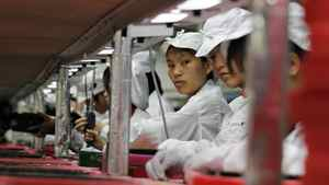 Workers are seen inside a Foxconn factory in the township of Longhua in the southern Guangdong province May 26, 2010.