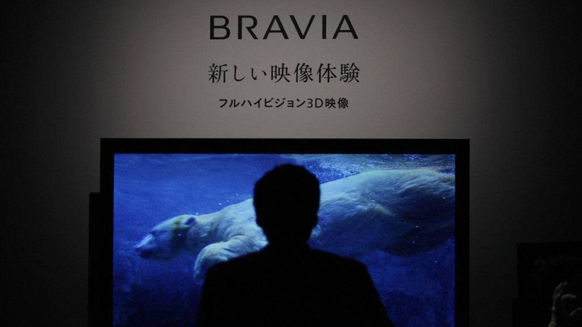 A man looks at Sony Corp's new 3D Bravia televisions at an unveiling in Tokyo March 9, 2010.