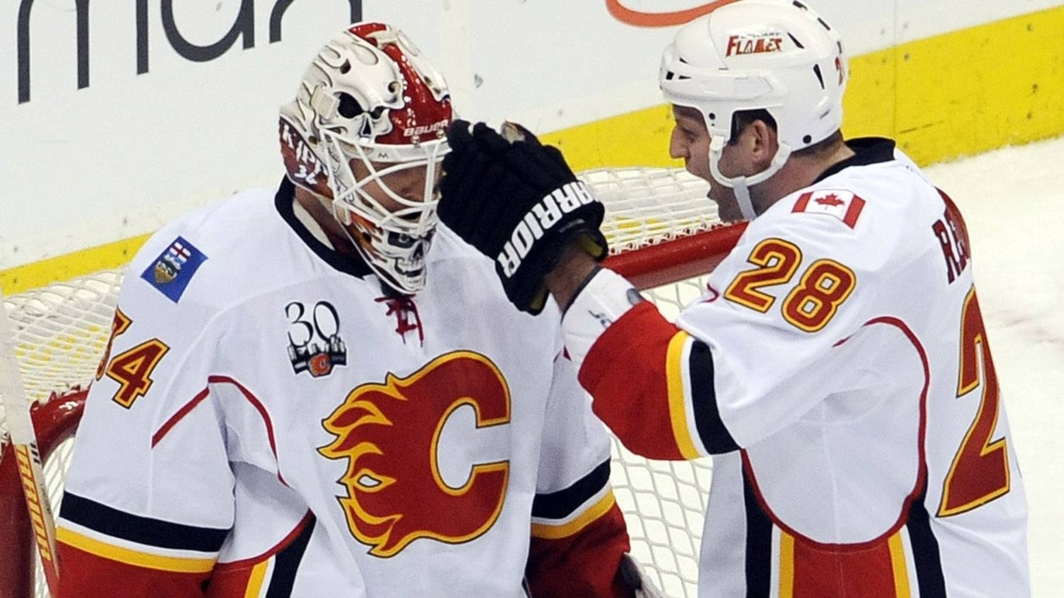 Calgary Flames Robyn Regehr (R) congratulates Miikka Kiprusoff (L) after beating the Colorado Avalanche in their NHL hockey game in Denver, Colorado April 2, 2010. REUTERS/Mark Leffingwell