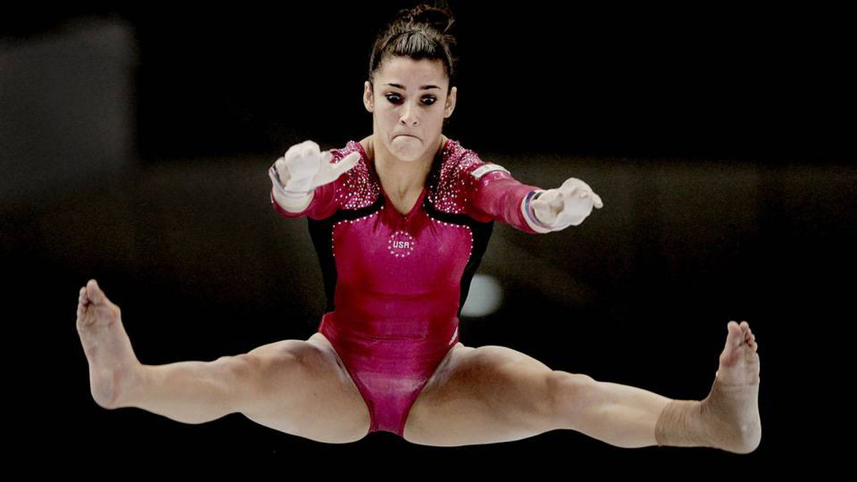 Alexandra Raisman of the United States competes on the uneven bars.
