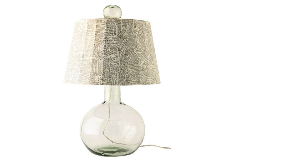 Talk about the last word in green design: The shade atop this fixture's bubble-studded recycled-glass base is collaged with repurposed dictionary pages. $468 at Anthropologie (www.anthropologie.com).