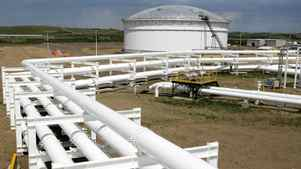 Pipelines feed crude oil into in the tank farm at the Enbridge Pipelines oil terminal facility in Hardisty, Alta