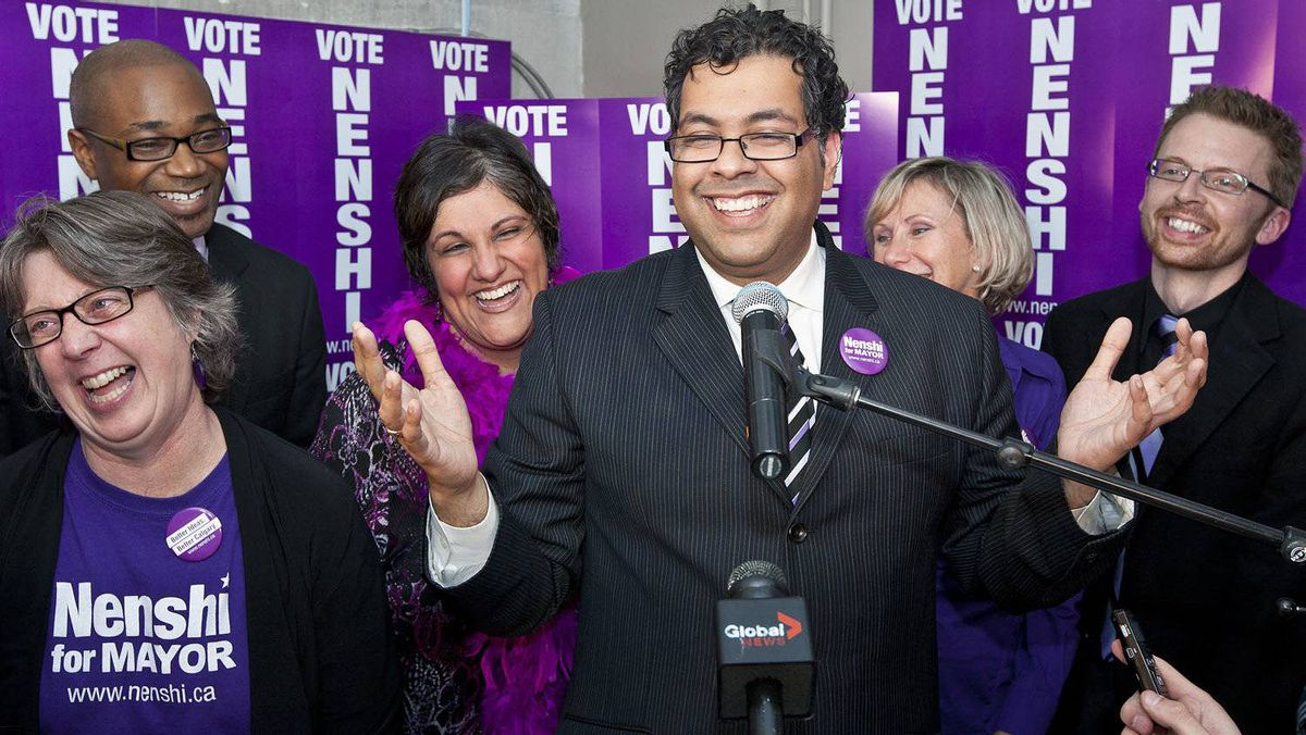 Mayoral candidate Naheed Nenshi celebrates his election win at his campaign office.