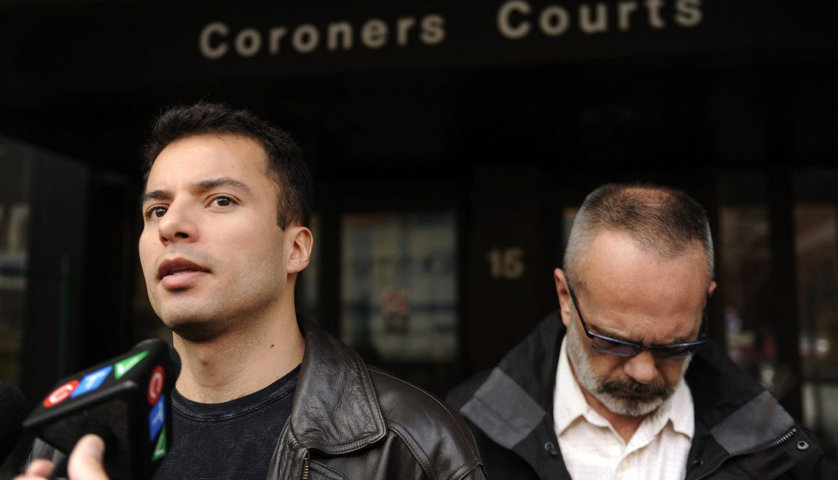 Alejandro Martinez-Ramirez, left, is photographed outside Coroners Court in Toronto on March 13, 2012 after the conclusion of an inquest into the death of his partner James Hearst.