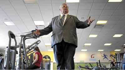 Mayor of Summerside Basil Stewart checks his weight at the Credit Union Place gym in Summerside, PEI.