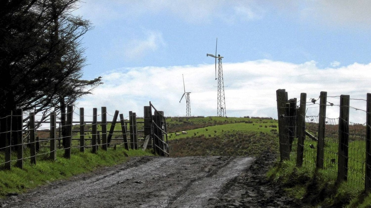 While a large turbine can generate energy for 5,000 homes, smaller windmills provide energy for a single household or farm, like this one in Isle of Luing, Scotland.