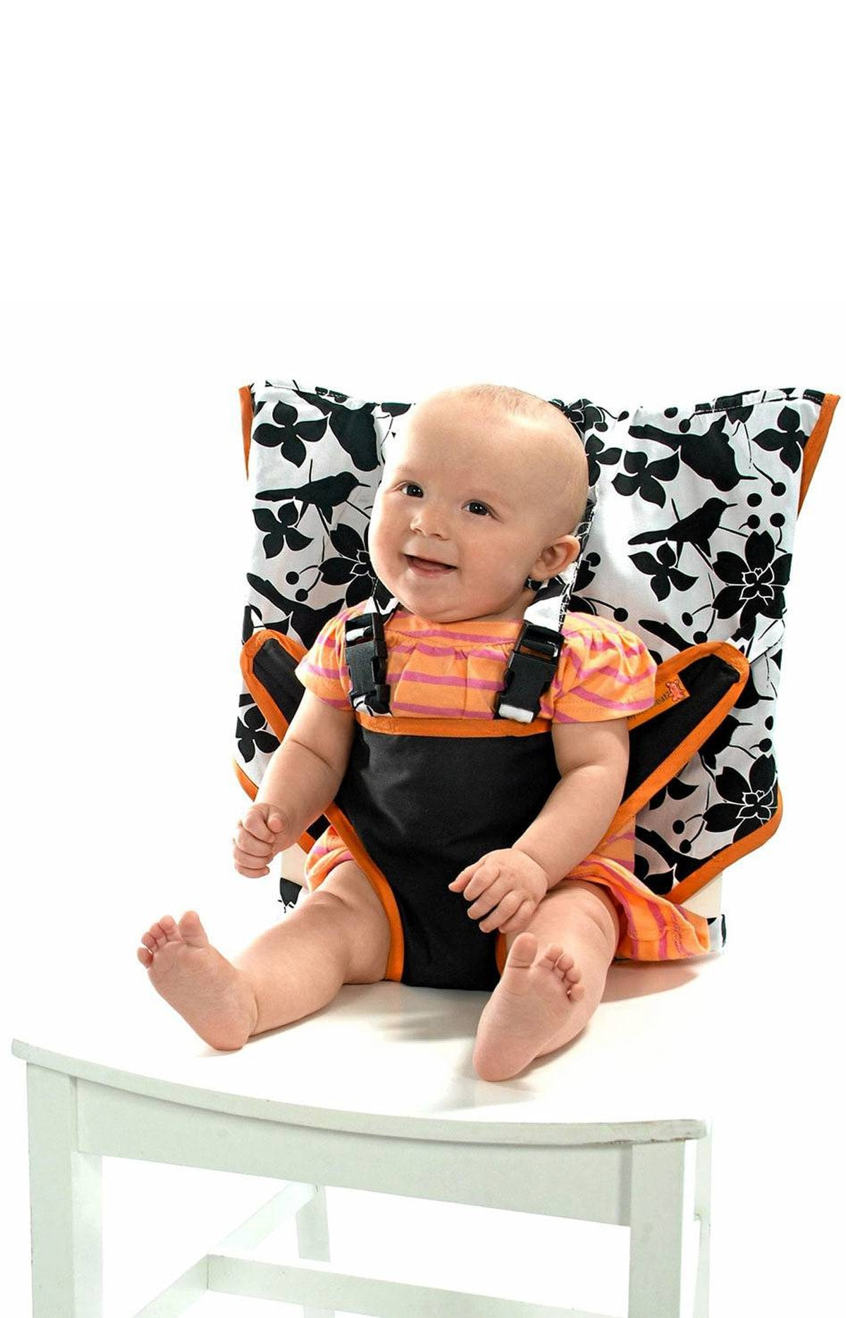 Sitting pretty Take your tot out for dinner in style with My Little Seat. Made from colourful machine-washable fabric, the portable high chair slips onto the back of most seats and comes with a five-point harness that keeps baby secure. It also folds down to the size of a diaper and tucks into its own storage bag. $29.99 (U.S.); mylittleseat.com