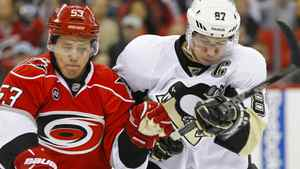 Pittsburgh Penguins center Sidney Crosby (87) and the Carolina Hurricanes center Jeff Skinner (53) battle for a loose puck during the 1st period at the RBC center. James Guillory-US PRESSWIRE