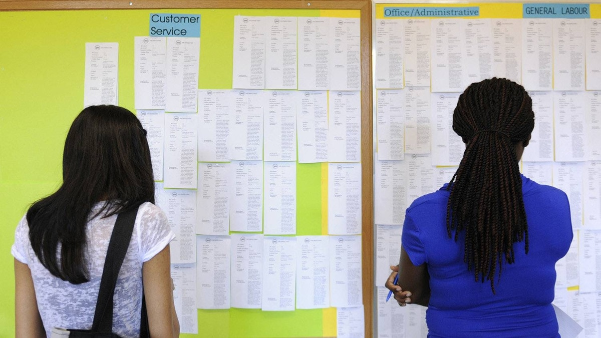 Young people look for jobs at a summer employment centre in Toronto.
