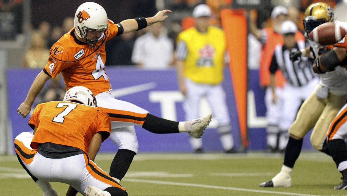B.C. Lions kicker Paul McCallum kicks a field goal during the first half of the CFL's 99th Grey Cup.