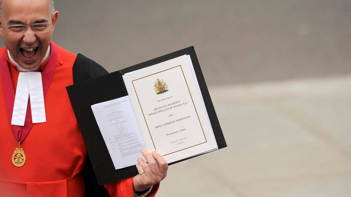The Right Reverend Dr John Hall, Dean of Westminster shows the Order of Service to spectators prior to the Royal Wedding of Prince William to Catherine Middleton at Westminster Abbey on April 29, 2011