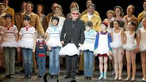 Sir Elton John wears a tutu as he joins the cast of the stage adaptation Billy Elliot The Musical for their curtain call following the show's premiere in Toronto on March 1, 2011.