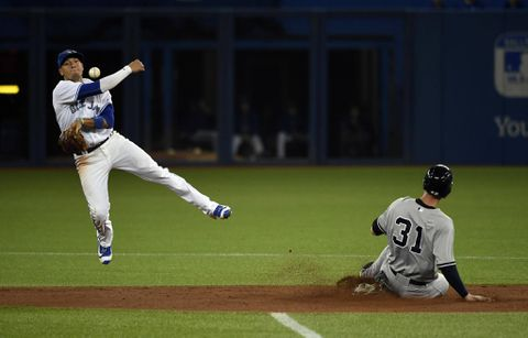 Stroman prevails with help from Girardi as Blue Jays beat the Yankees