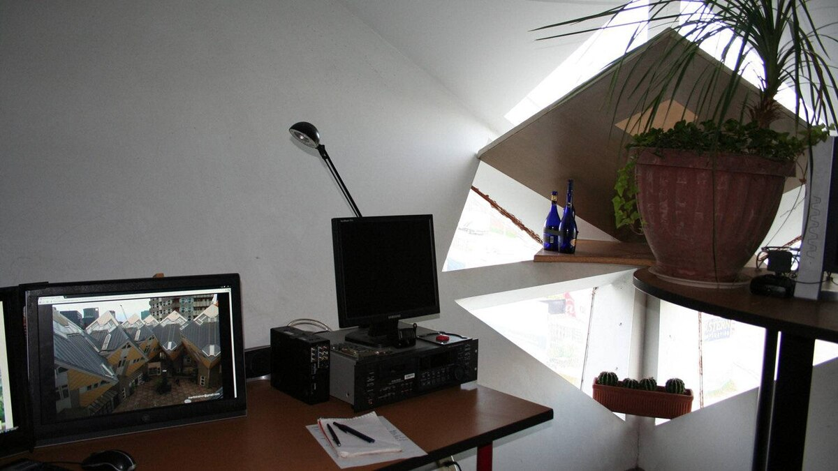 The office, with Rotterdam cubes on the computer screen.