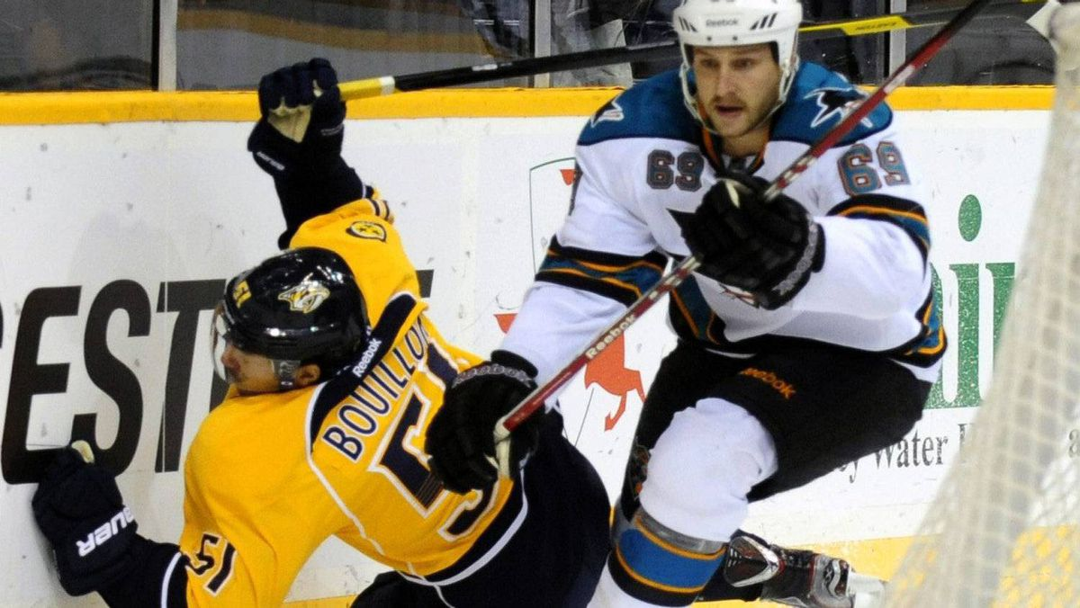 Nashville Predators defenseman Francis Bouillon (51) goes down after being tripped by San Jose Sharks center Andrew Desjardins (69) in the first period of an NHL hockey game on Saturday, Feb. 25, 2012, in Nashville, Tenn. The Preds won 6-2. (AP Photo/Mike Strasinger)