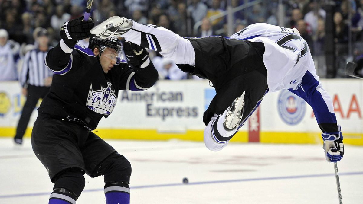 Tampa Bay Lightning centre Mattias Ritola flies through the air after a hit from Los Angeles Kings defenceman Jack Johnson.
