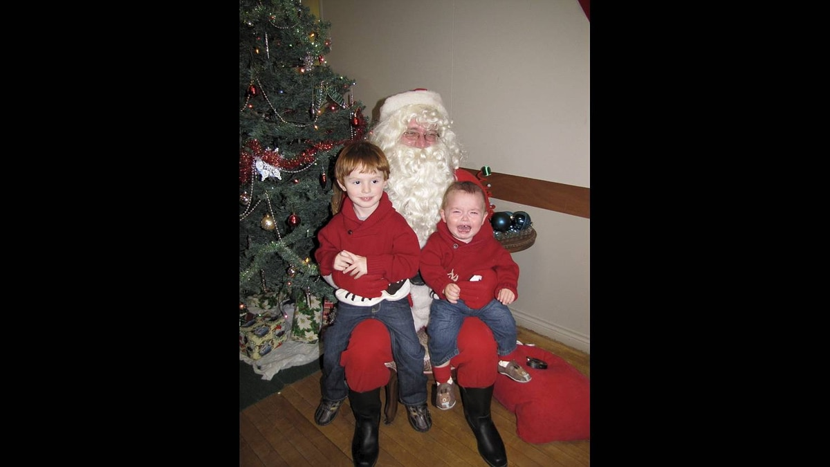 Meaghan Force photo: Scream and say cheese! - Everett and Brenden were excited to see Santa. That was until Brenden had to sit on his knee. He took 1 look at Santa and screamed! Poor Santa! He sure got an earful!
