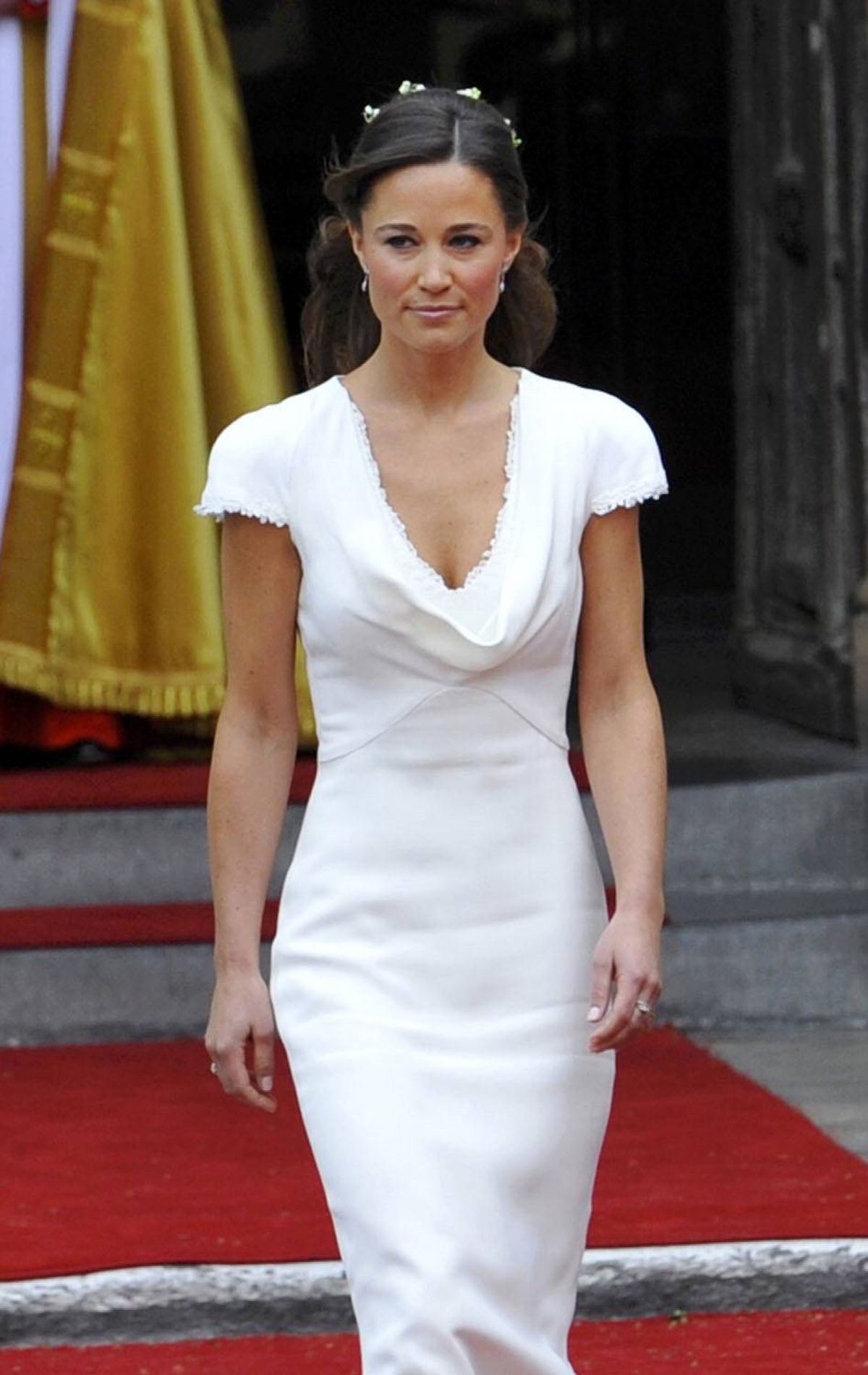 As maid of honour at the royal wedding, Pippa nearly stole the show in a white body-hugging Alexander McQueen gown.