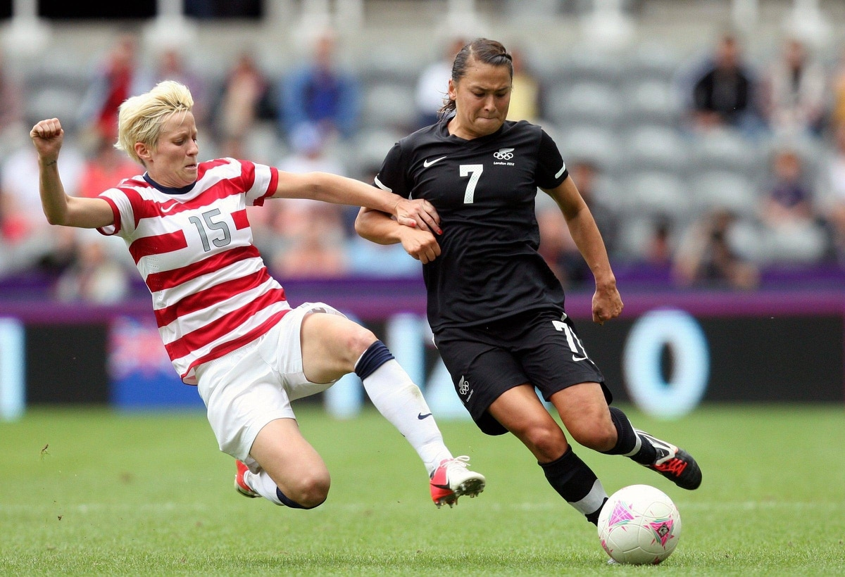 United States' Megan Rapinoe, left, vies for the ball with New Zealand's Ali Riley during their women's quarter-final soccer match at St James' Park in Newcastle, England. The United States won the game 2-0.