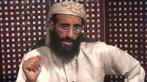 In this image taken from video and released by SITE Intelligence Group on Monday, Nov. 8, 2010, Anwar al-Awlaki speaks in a video message posted on radical websites. Al-Awlaki, the U.S.-born radical Yemeni cleric linked to previous attacks on the U.S., called for Muslims around world to kill Americans in the new video message.