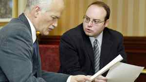 NDP Leader Jack Layton goes over notes with Pierre Ducasse, his special Quebec advisor, on Feb. 1, 2005 in Montreal