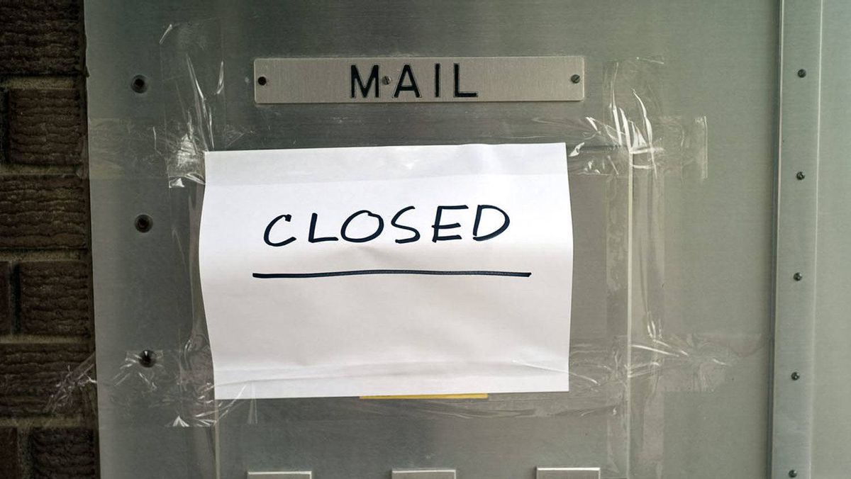 """A mailbox covered over by a """"closed"""" sign greeted people wanting to mail letters in Calgary, Alta., Wednesday, June 15, 2011."""