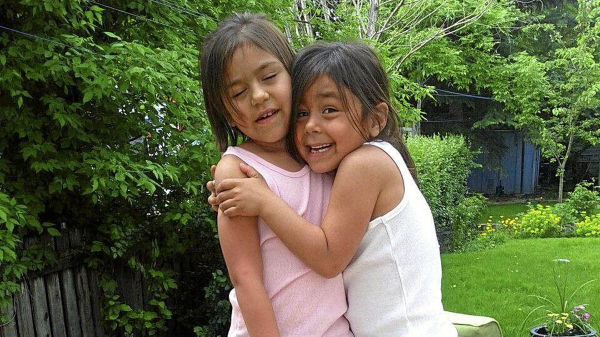 Gabrielle Eckalook, left, was one of three survivors in a plane crash in Resolute Bay. Her sister Cheyenne, 6, was among the 12 who died.