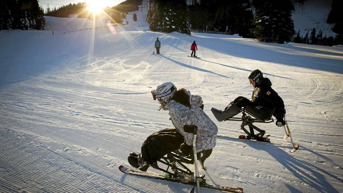 Brad Lennae, right, and his student, Chelaine McInroy, make their way to the chair lift on Dec. 9, 2011. Mr. Lennae, a Paralympic skier, coaches with the Whistler Adaptive Sports Program, a not-for-profit society that provides recreational programs for people with disabilities.