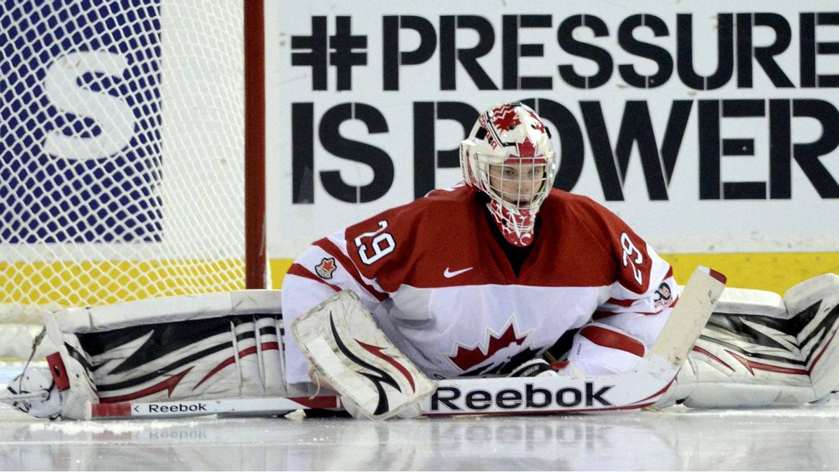 Canada's goalie Mark Visentin stretches before the start of the third period against Denmark at the 2012 IIHF U20 World Junior Hockey Championships in Edmonton, Alberta, December 29, 2011.