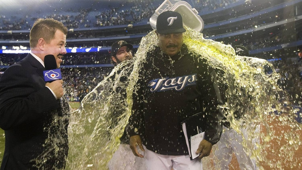 Toronto Blue Jays General Manager Cito Gaston centre, gets gatorade dumped on him by players Ricky Romero and Shaun Marcum during an interview following AL action against the New York Yankees on Wednesday, September 29, 2010. THE CANADIAN PRESS/Nathan Denette