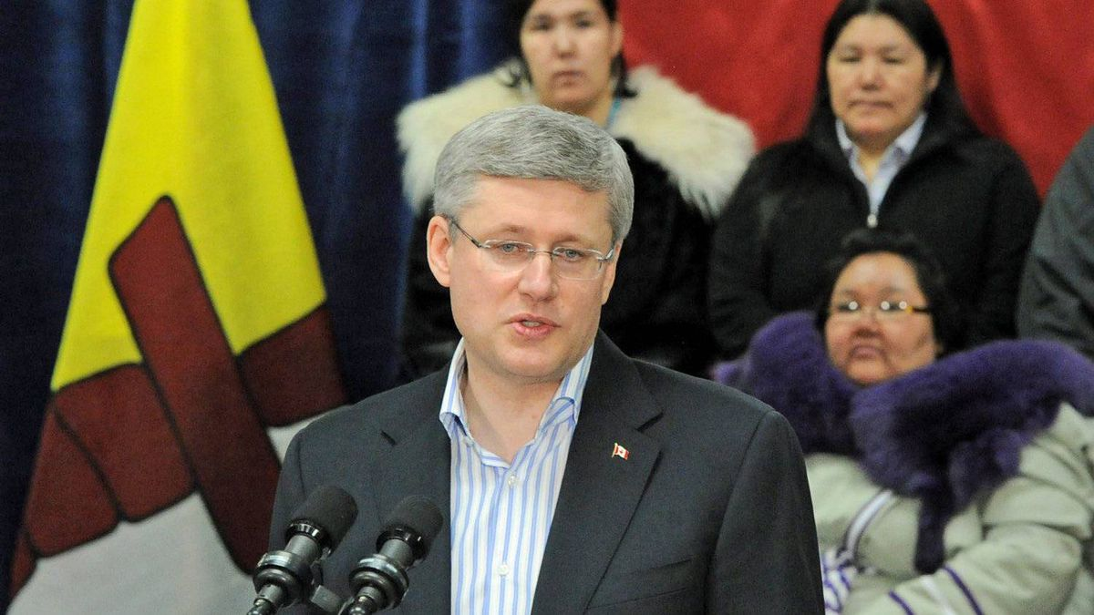 Prime Minister Stephen Harper takes questions at the Nunavut Arctic College in Iqaluit on Feb. 23, 2012.
