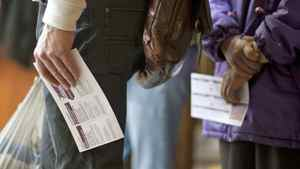 Voters wait to cast their ballots in the federal election at an advance polling station in Vancouver on April 22, 2011.