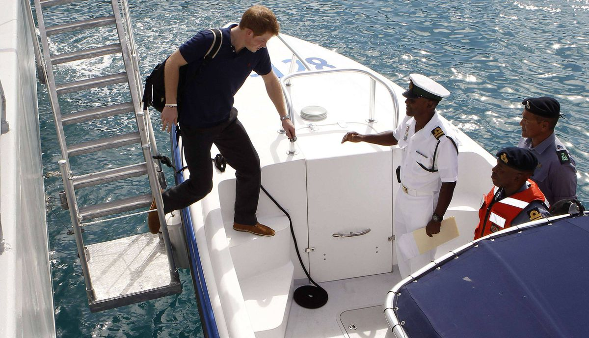 Prince Harry boards a boat for Harbour Island in Nassau, Bahamas on March 4, 2012.