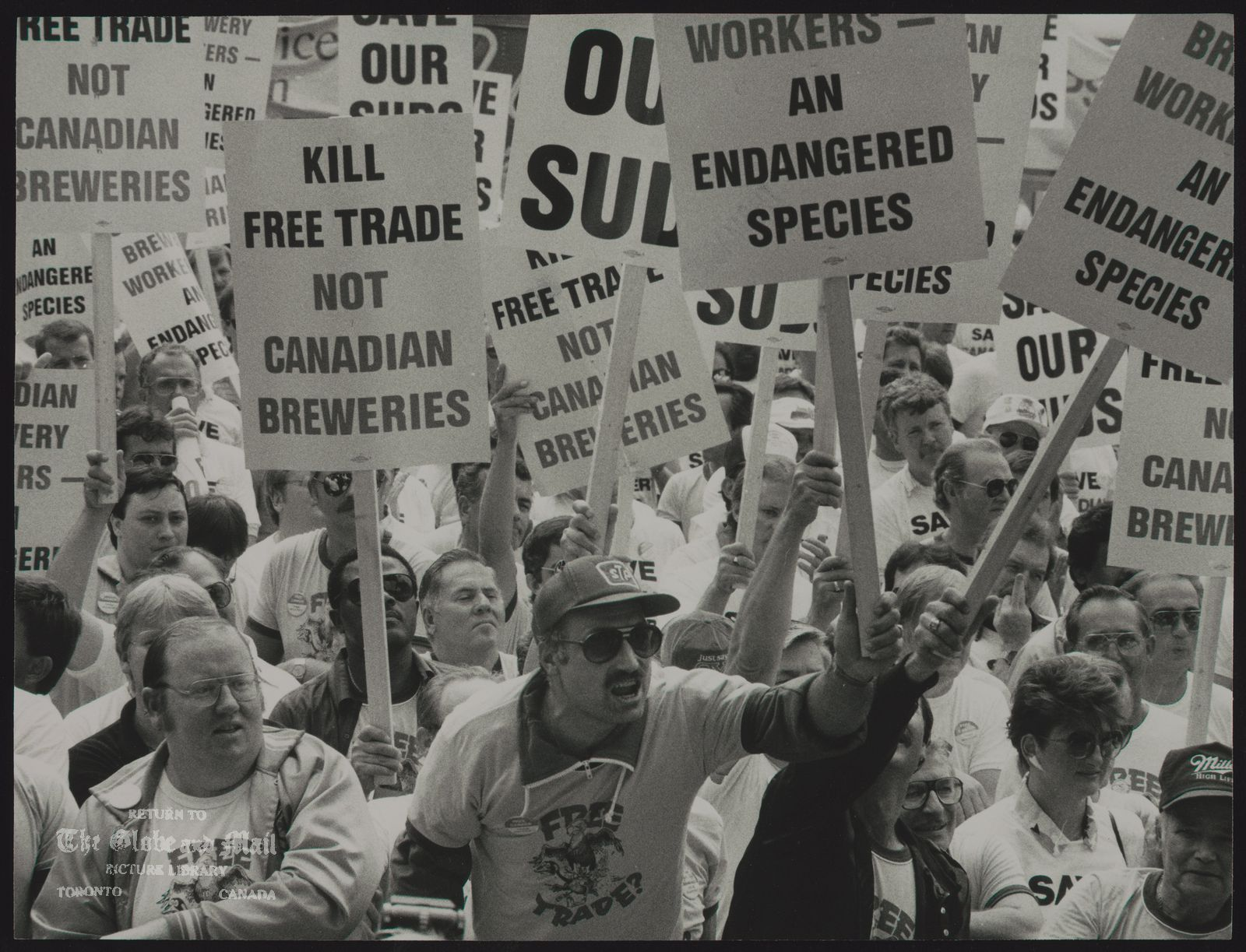 FREE TRADE Angry brewery workers gather at Queen's Park in Toronto.